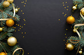 istock Black Christmas background with golden decorations, baubles, fir tree branches, confetti. Christmas holiday celebration, winter, New Year concept. Christmas banner mockup, greeting card template. 1171586251