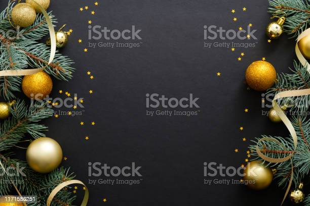 Black christmas background with golden decorations baubles fir tree picture id1171586251?b=1&k=6&m=1171586251&s=612x612&h=vkoma0iaa v1  zebaxp2de3p2mnp8mnh8poosq xms=