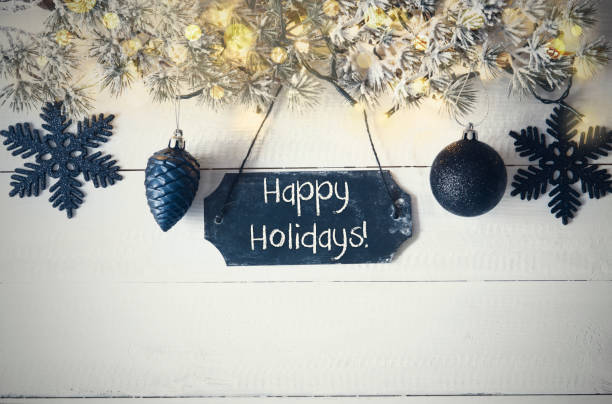 black christmas plate, fairy light, text happy holidays - happy holidays stock pictures, royalty-free photos & images