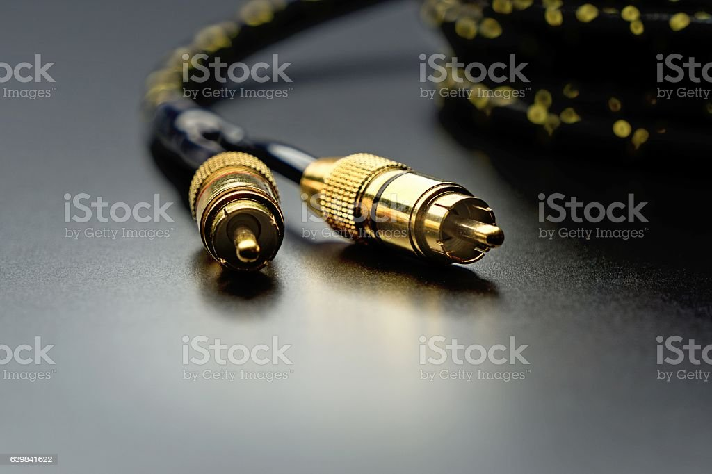 Black cinch audio cable with golden plugs stock photo