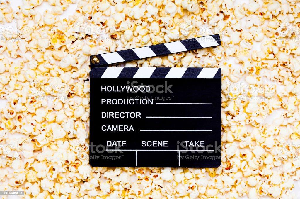 Black Clapperboard on popcorn stock photo