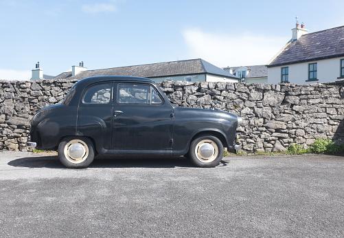 Black classic British car in UK village
