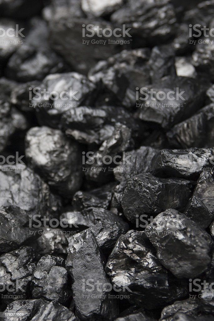 Black coals with a shallow depth of field stock photo