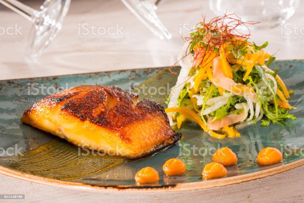 Black cod miso marinated Black cod miso marinated with salad Aperitif Stock Photo
