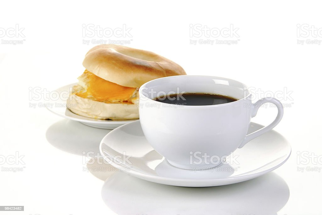 Black coffee and a bagel royalty-free stock photo