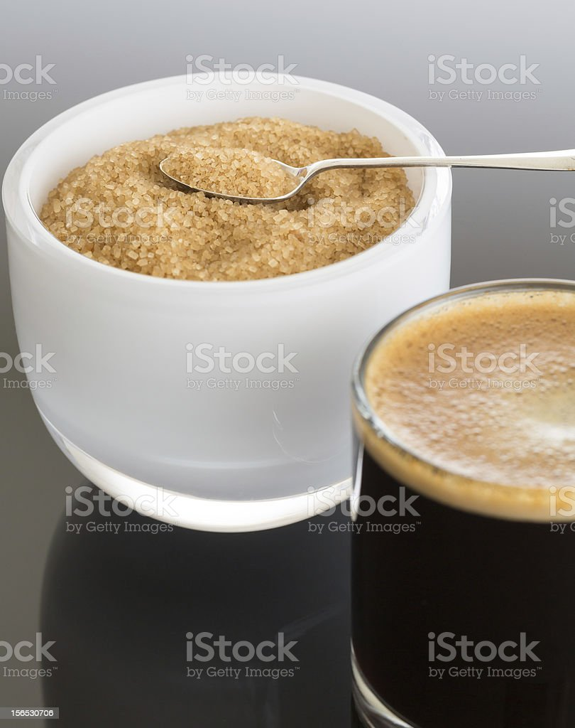 Black coffee and froth in glass mug with sugar royalty-free stock photo