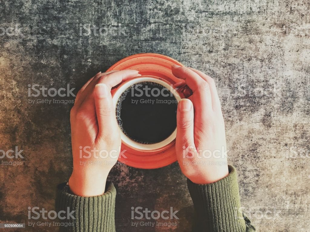 black coffee and hands stock photo
