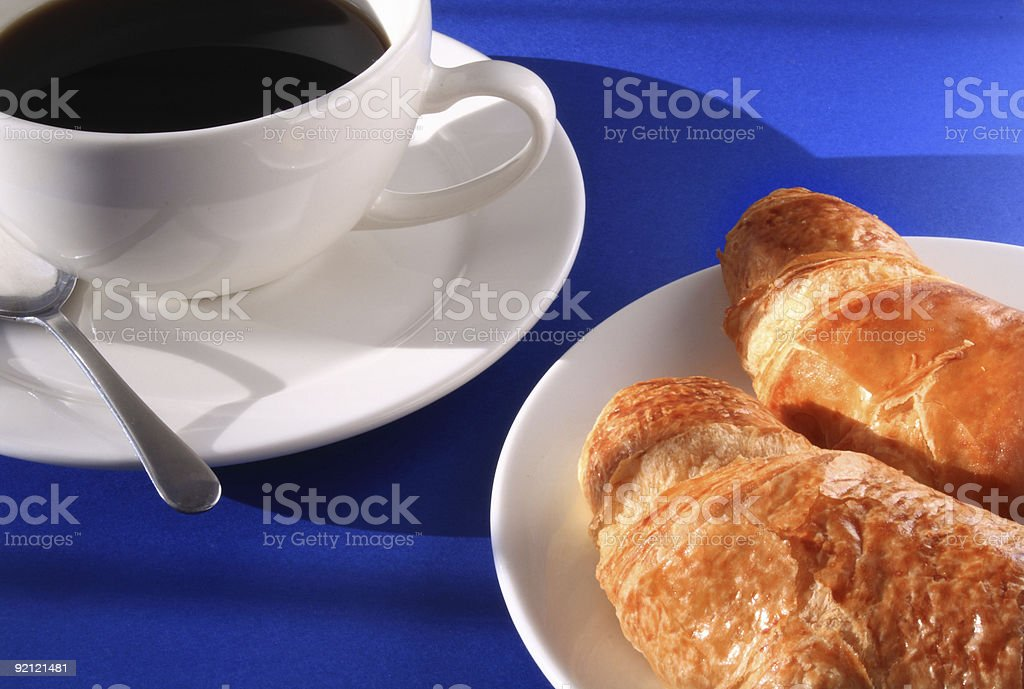 Black coffee and two croissants royalty-free stock photo