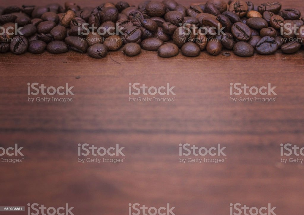 Black coffee beans on a brown tree royalty-free stock photo