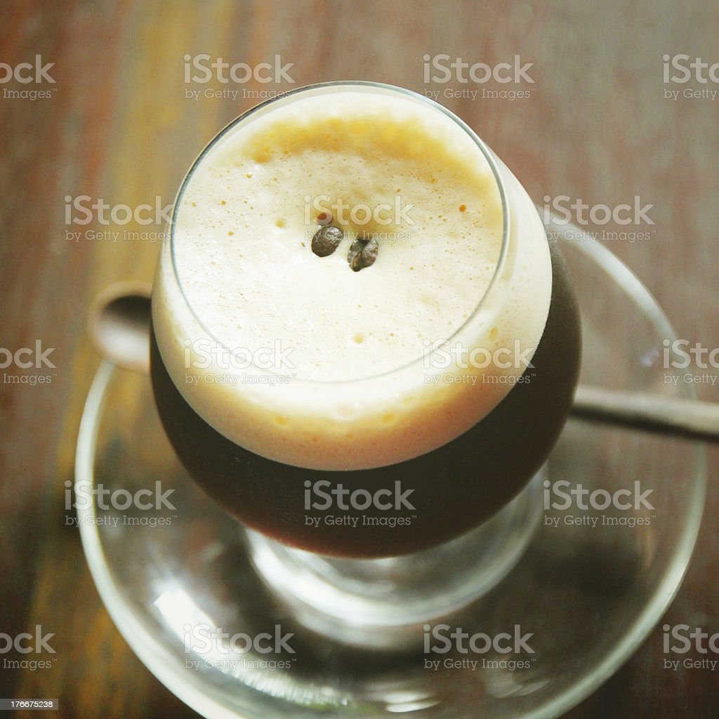 Black coffee, cold milk with retro filter effect royalty-free stock photo