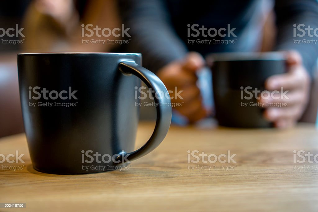 black coffee cup on table, chatting and dating stock photo