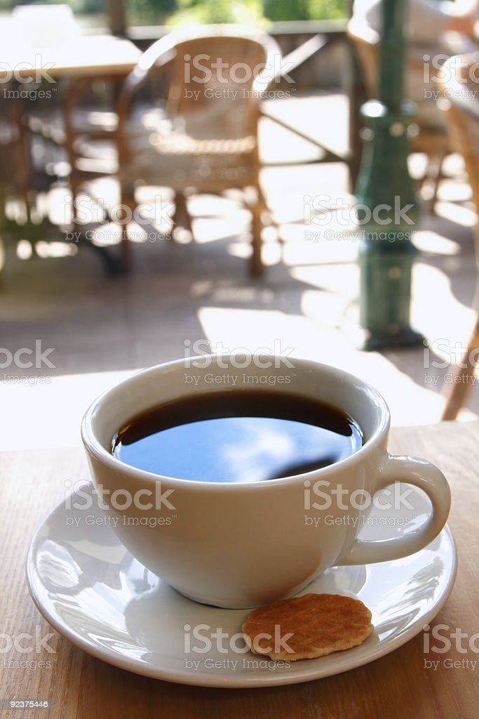 black coffee cup with biscuit and morning cafe background royalty-free stock photo