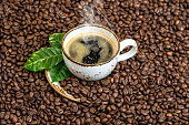 Black coffee green leaves caffee beans background