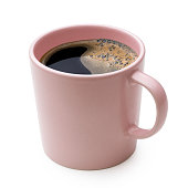 Black coffee in a pink ceramic mug isolated on white.
