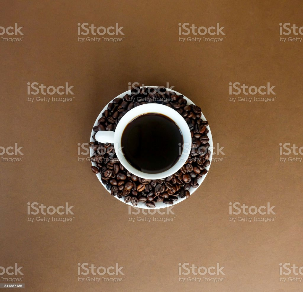 black coffee in a white cup and coffee roast beans. stock photo