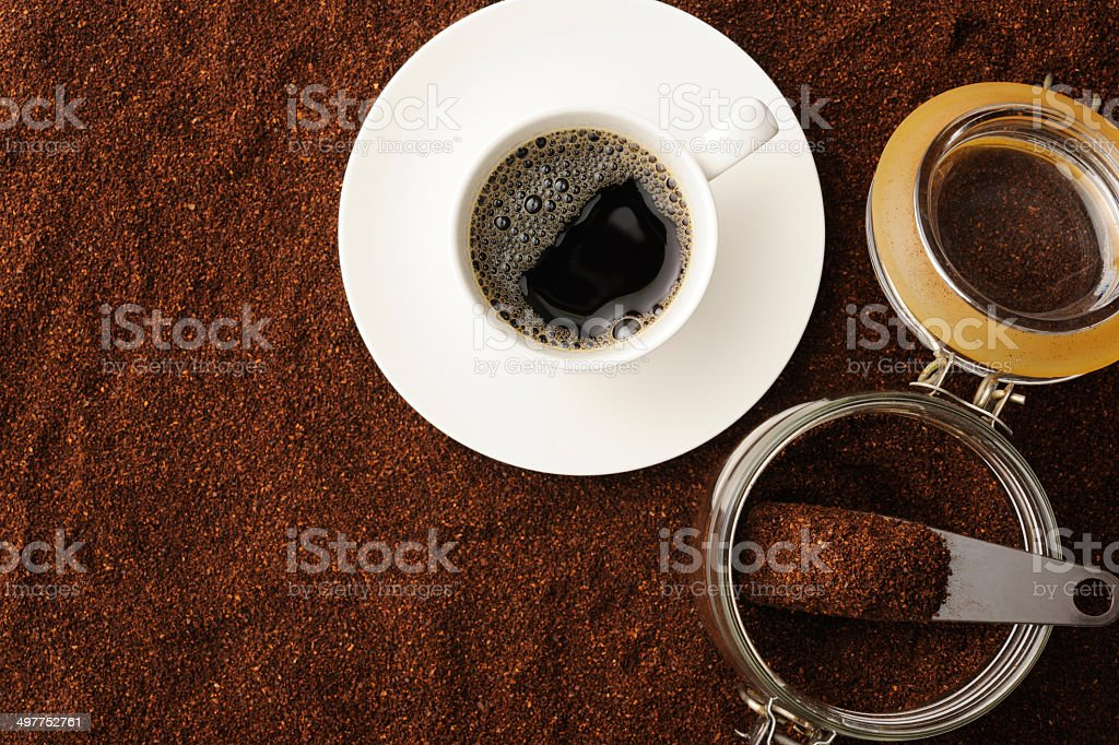 Black coffee in white coffee cup on ground coffee beans royalty-free stock photo