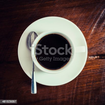 519529874 istock photo Black coffee in white cup on wooden 481529357