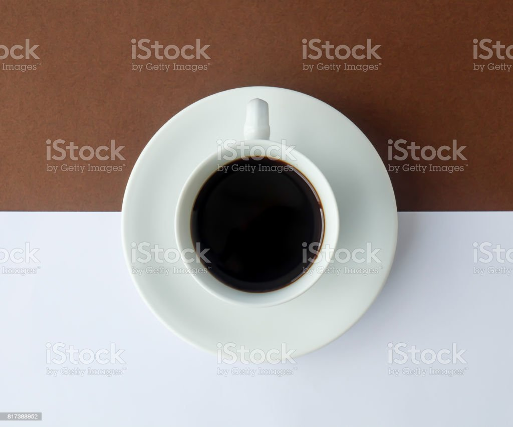 Black coffee in white cup put on white paper for add some text. stock photo