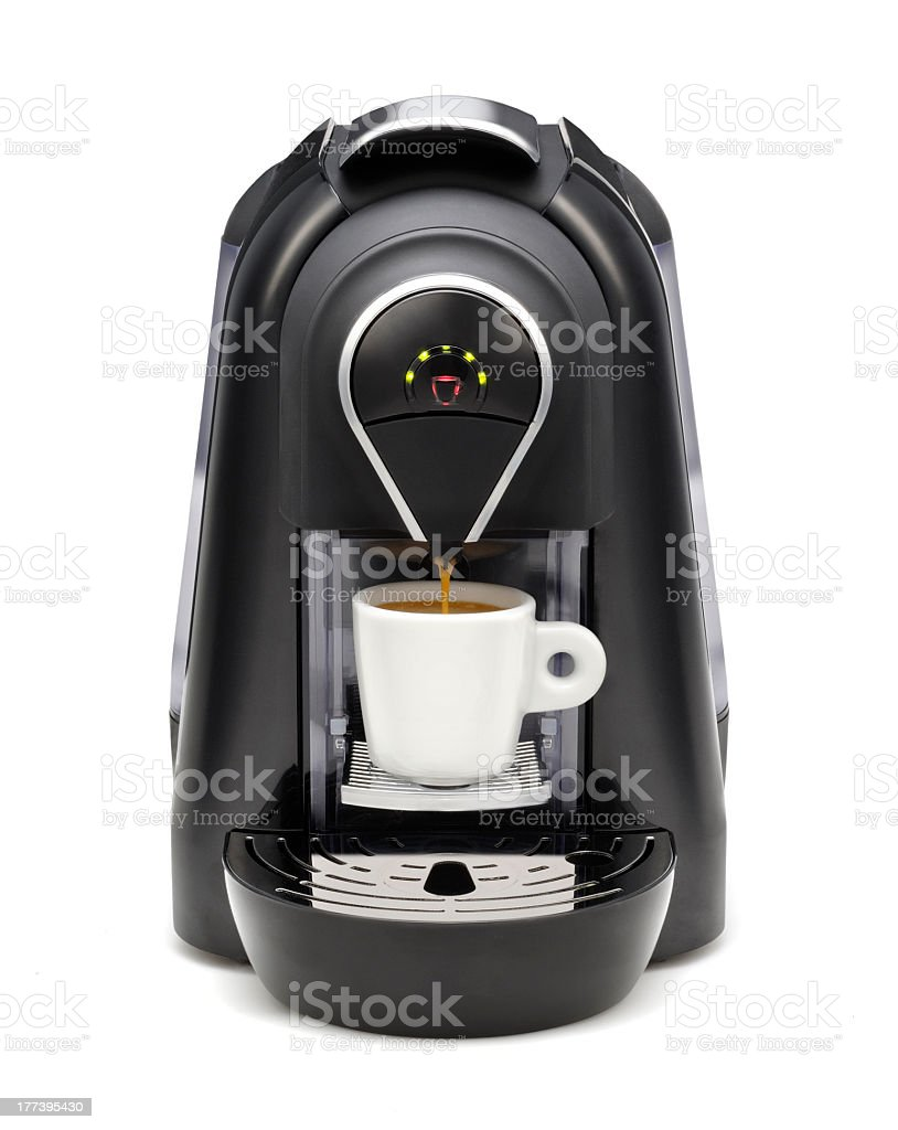A black coffee maker with green LED lights stock photo