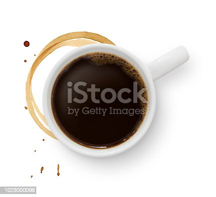 Top view of a black coffee mug with coffee stain isolated on white around the mug (excluding the shadow)