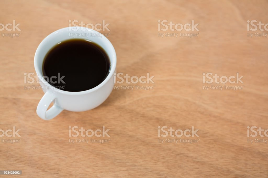 Black coffee on wooden table stock photo
