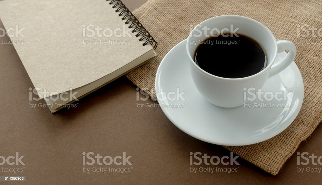 black coffee white cup and notebook. stock photo