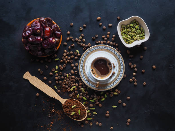 Black coffee with cardamom and dates. Traditional Arabic coffee. Black coffee with cardamom and dates. cardamom stock pictures, royalty-free photos & images