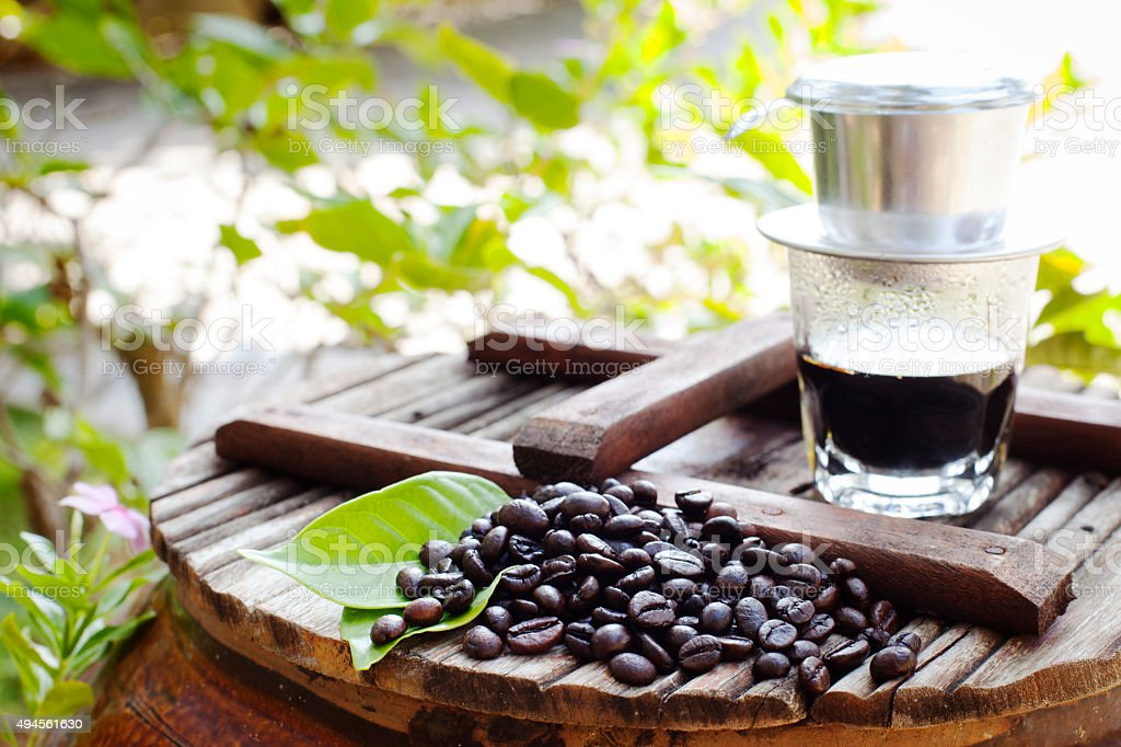 Black coffee with freshly roasted beans. Vietnamese style. stock photo
