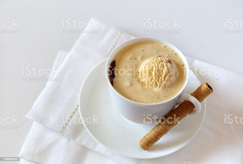 Black coffee with ice cream and chocolate stick stock photo