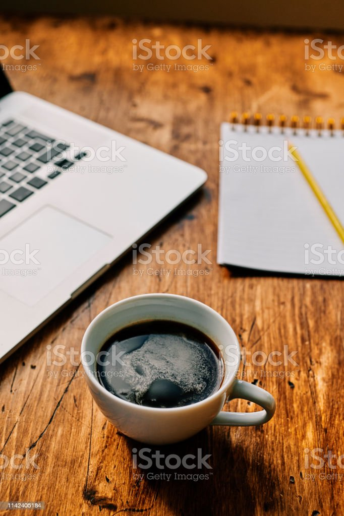 Black coffee with laptop and notepad. stock photo