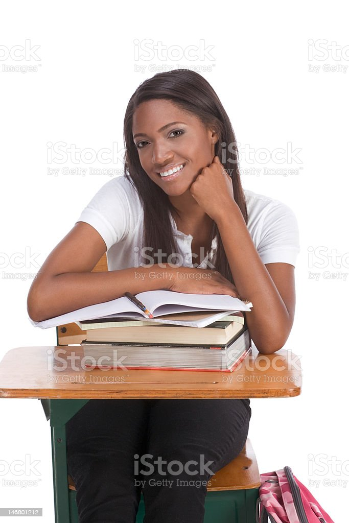 Black college student woman with book by desk royalty-free stock photo
