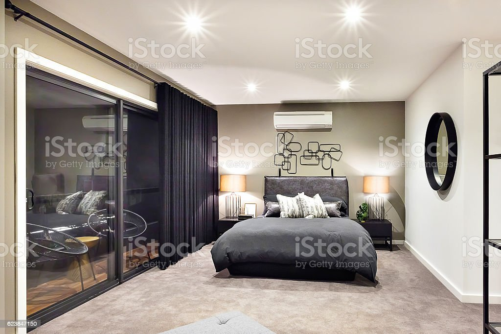 Black color bed in luxurious hotel with flashing lamps stock photo
