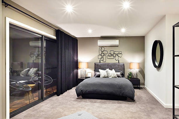 Black color bed in luxurious hotel with flashing lamps – Foto