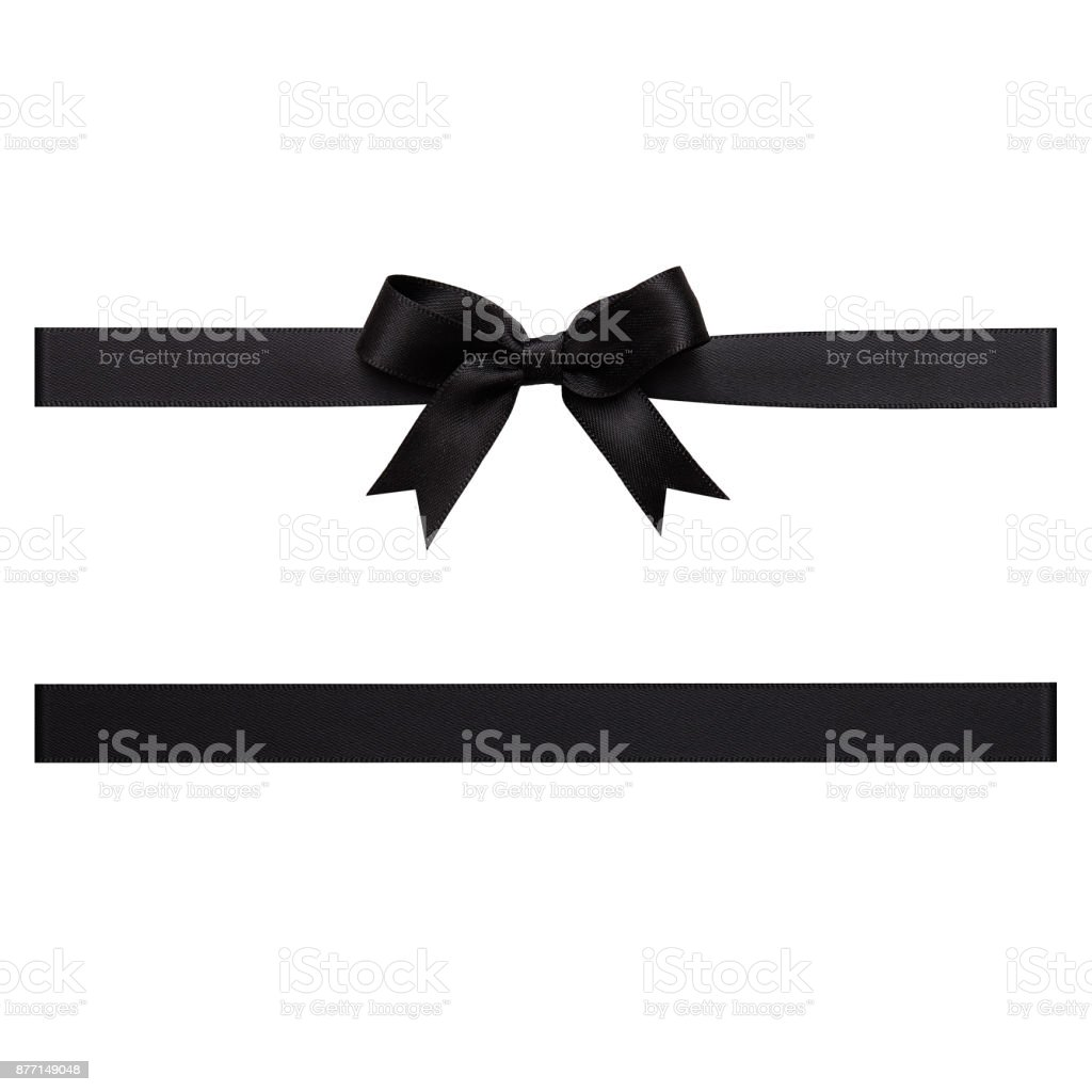 Black color gift ribbon tied in a bow on white background, cut out top view stock photo