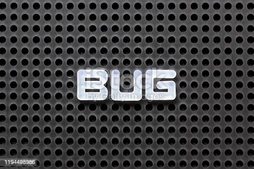 istock Black color pegboard with white letter in word bug 1194498986