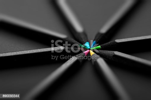 istock black, colored pencils, on black background 890093344