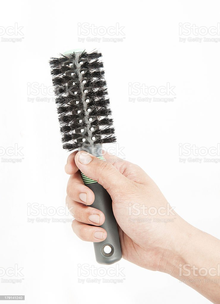 black comb in his hand royalty-free stock photo