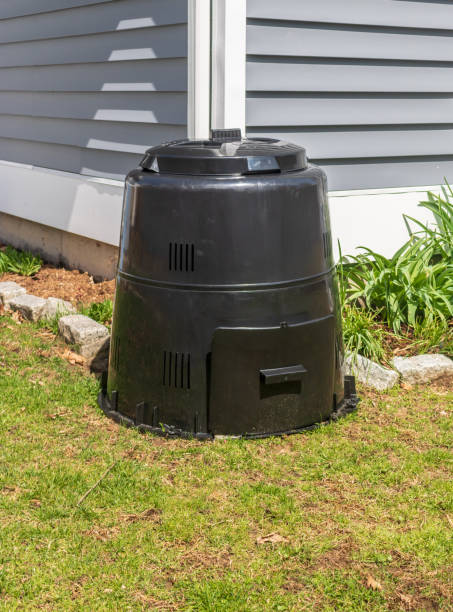Black composter in a yard stock photo