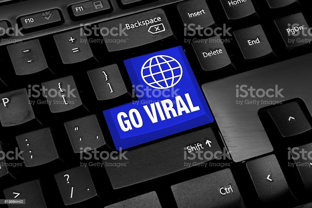 Black Computer keyboard with blue go viral button stock photo