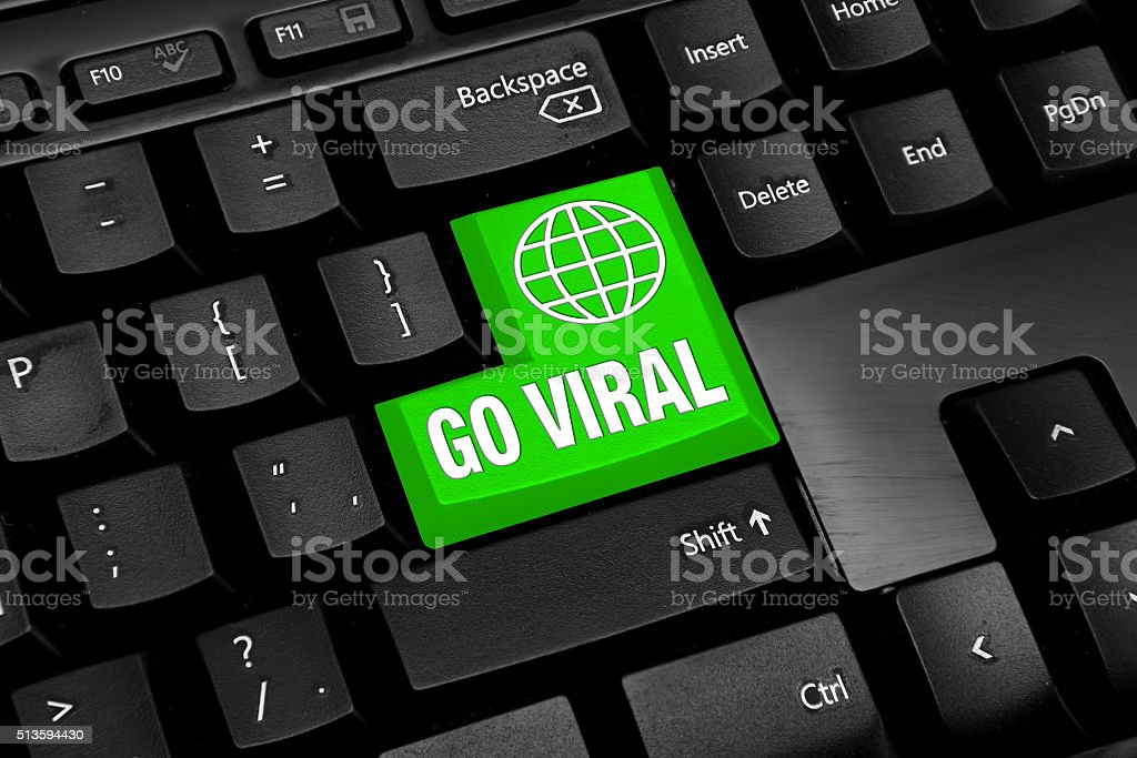 Black Computer keyboard with green go viral button stock photo