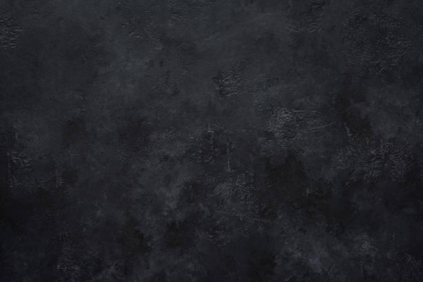 Black concrete wall background Black concrete wall background. Texture of black concrete cement stock pictures, royalty-free photos & images