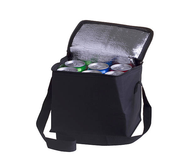 Black cooler bag filled with softdrink cans stock photo