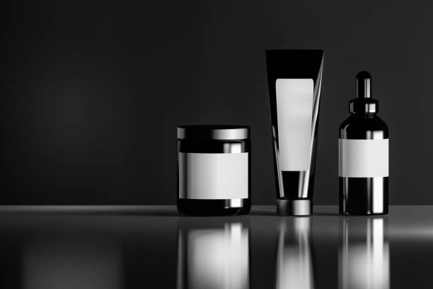Black cosmetic bottles stock photo