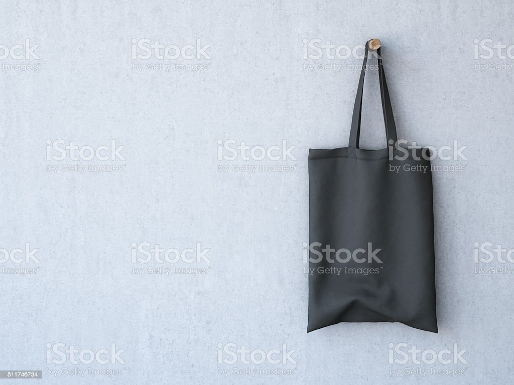 Black Cotton Bag On The Concrete Wall 3d Rendering Stock