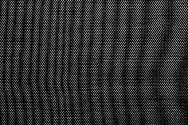 Black cotton shirt texture. Close up black Cotton Pinpoint Oxford fabric texture is commonly used to manufacture men's dress shirts, for everyday work shirts. Black cotton shirt texture. menswear stock pictures, royalty-free photos & images
