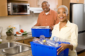 Black couple doing recycling in the kitchen