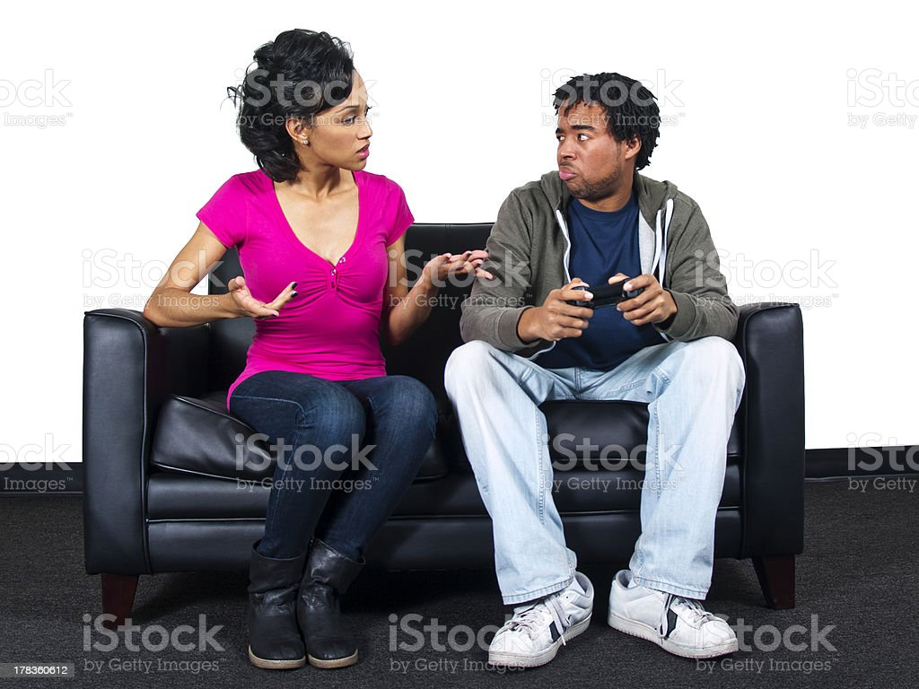 Black Couple Fighting Over a Video Game Controller royalty-free stock photo