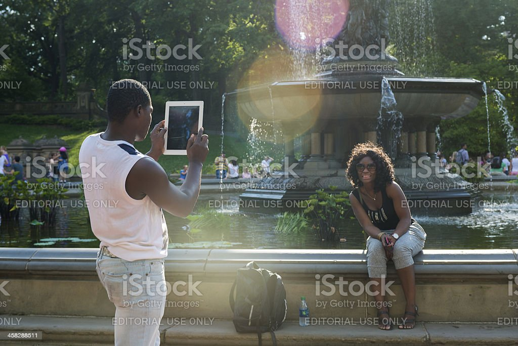 Black Couple Takes Photo with iPad in Central Park royalty-free stock photo