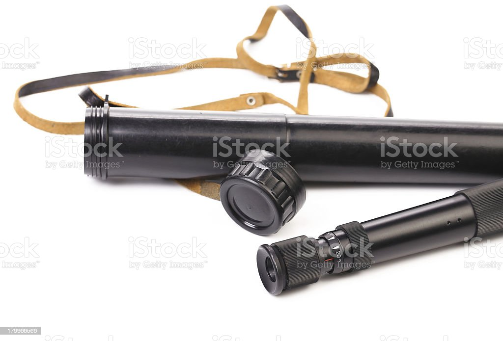 Black cover and spyglass lying. royalty-free stock photo