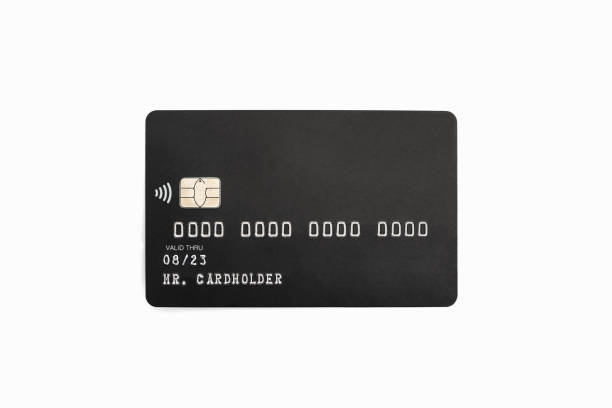 Black credit card isolated on white background stock photo